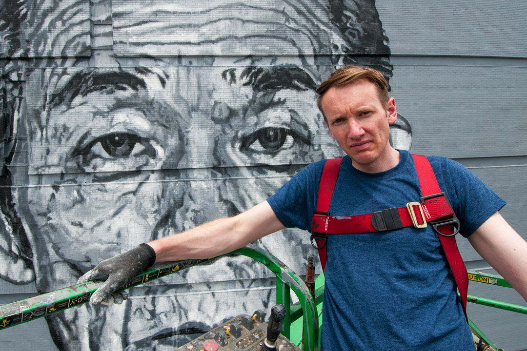 ECB near completion of his mural for Open Walls Baltimore 2014