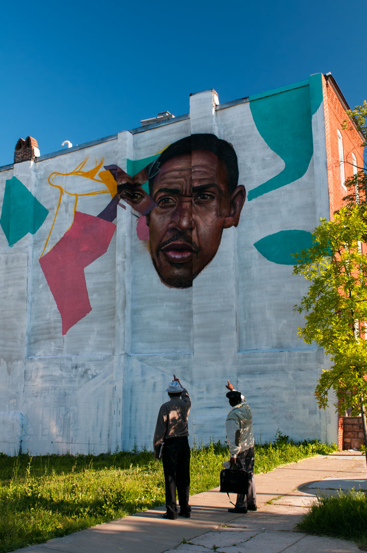 Neighbors pointedly discussing El Decertor's mural for Open Wall