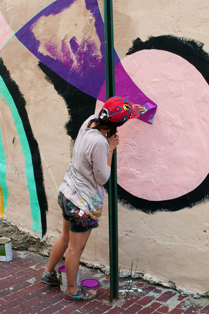 Jessie Unterhalter at work on the mural she & Katey Truhn are pa