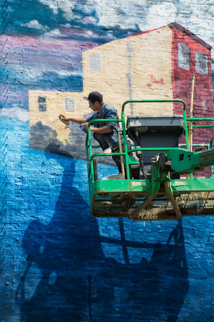 Nanook at work on his mural for Open Walls Baltimore 2014