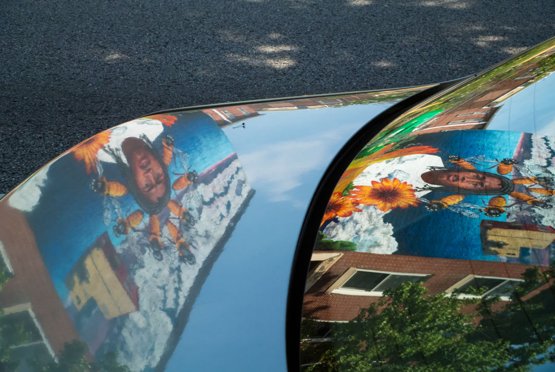 Reflection of Nanook's mural for Open Walls Baltimore 2014