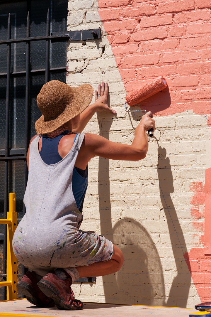 Katey Truhn at work on the Warner Street Mural