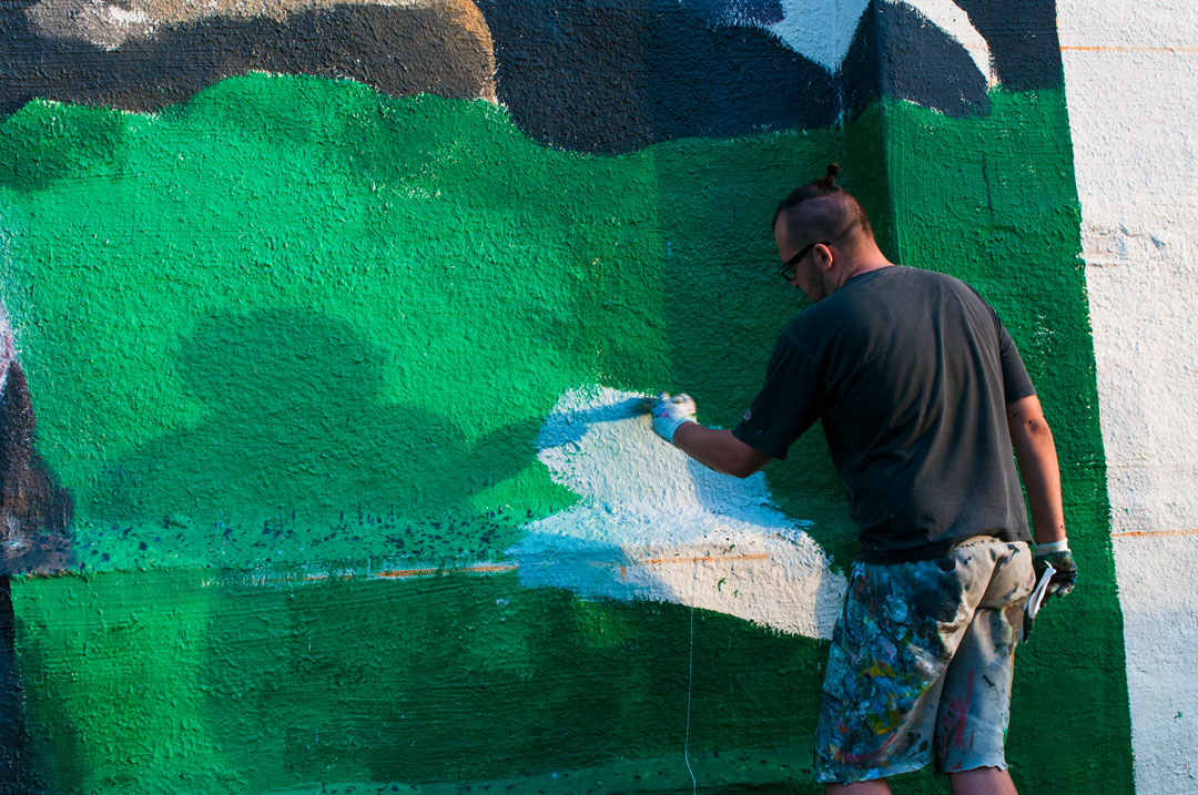 Zbiok at work on his mural for Open Walls Baltimore 2014