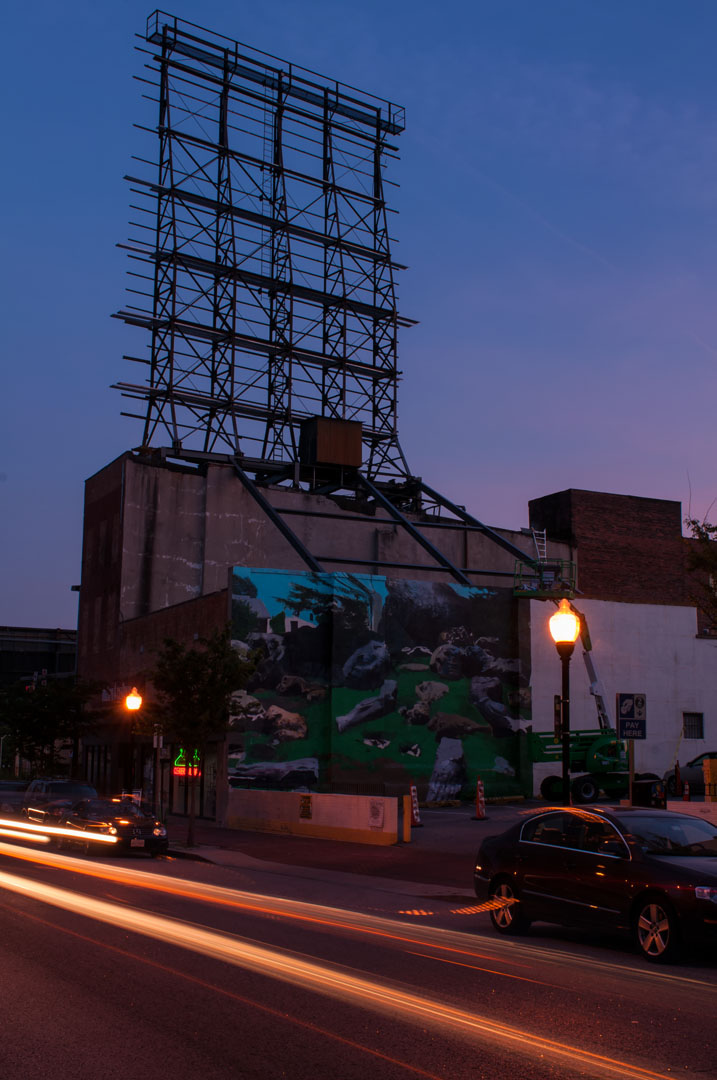 An evening twilight view of Zbiok's mural for Open Walls Baltimo