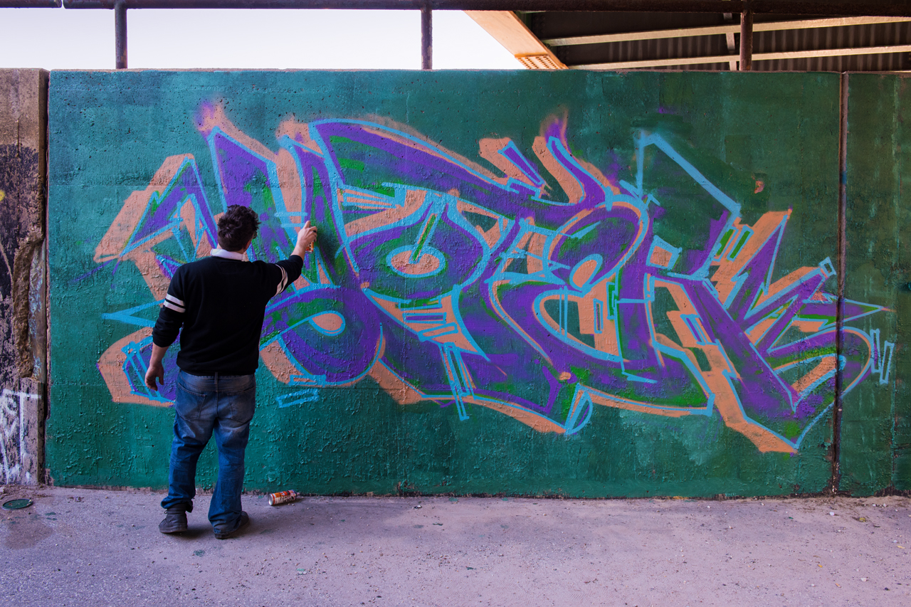 Moter at work on the Section 1 Art Park entrance wall