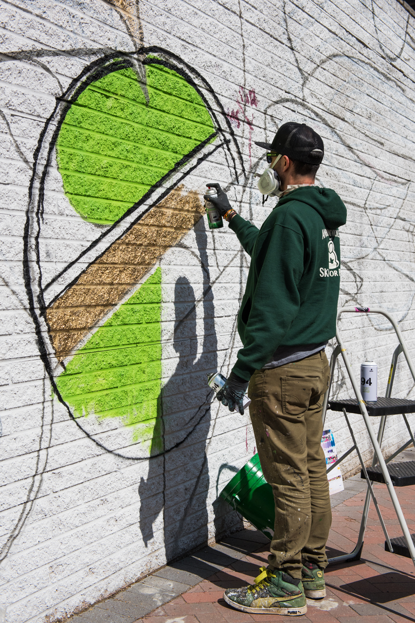 Mas Paz at work on the east side of the 23rd Street mural