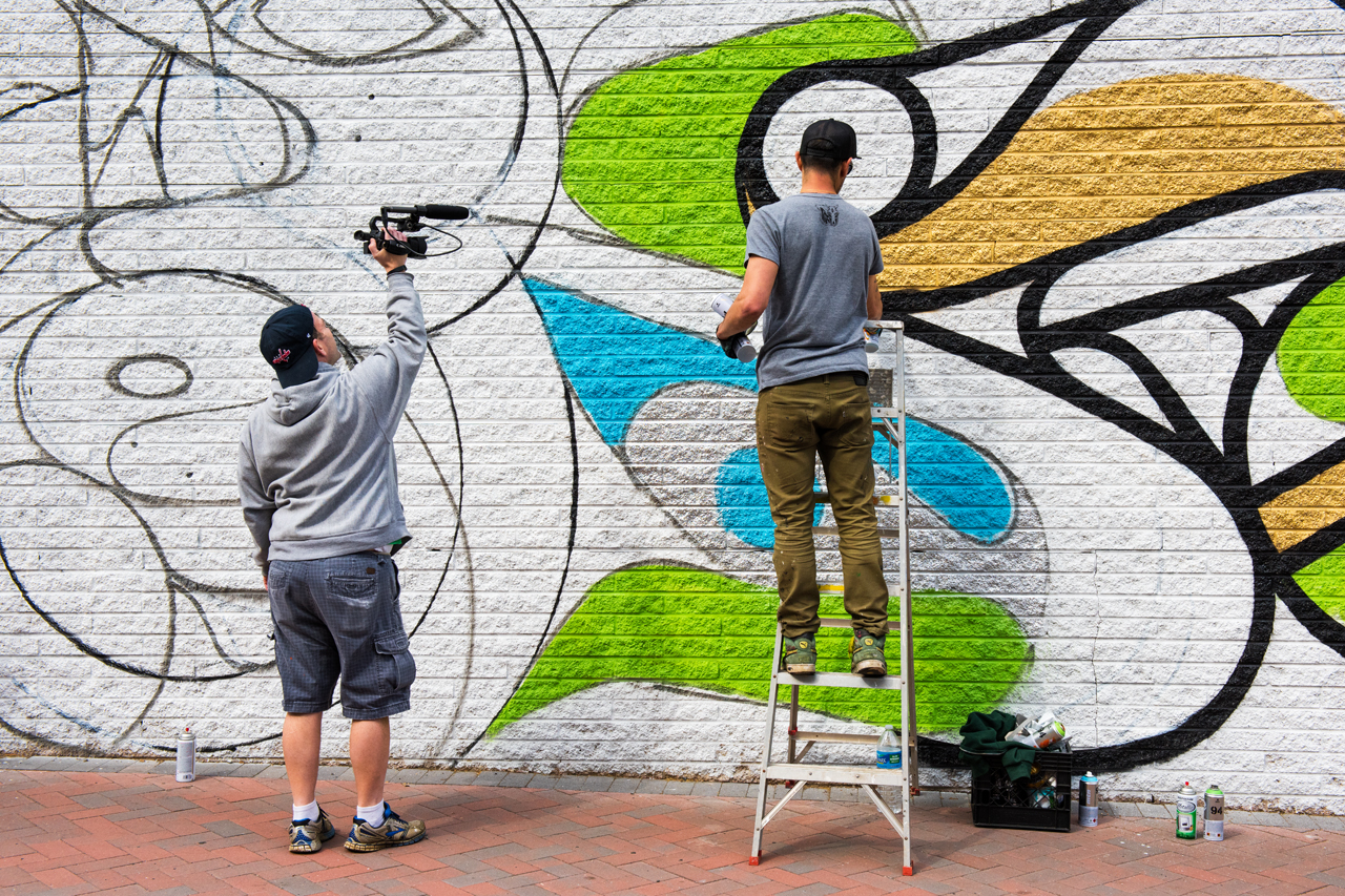 Brian White of Street Art Films catching Mas Paz in action
