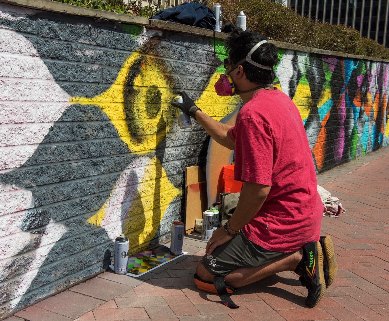 Jeff Huntington at work on the west side of the 23rd Street mural