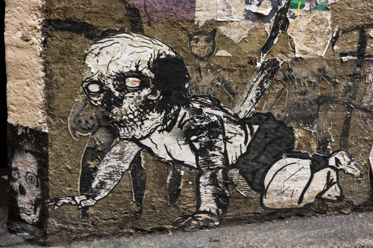 Skeletal crawler - wheatpaste by unidentified artist