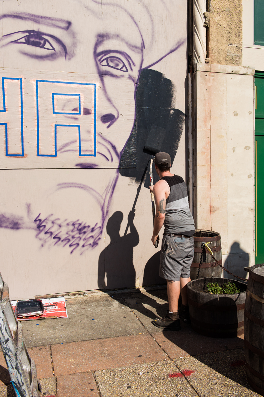 Nether begins work on his mural of videographer Ramsey Orta