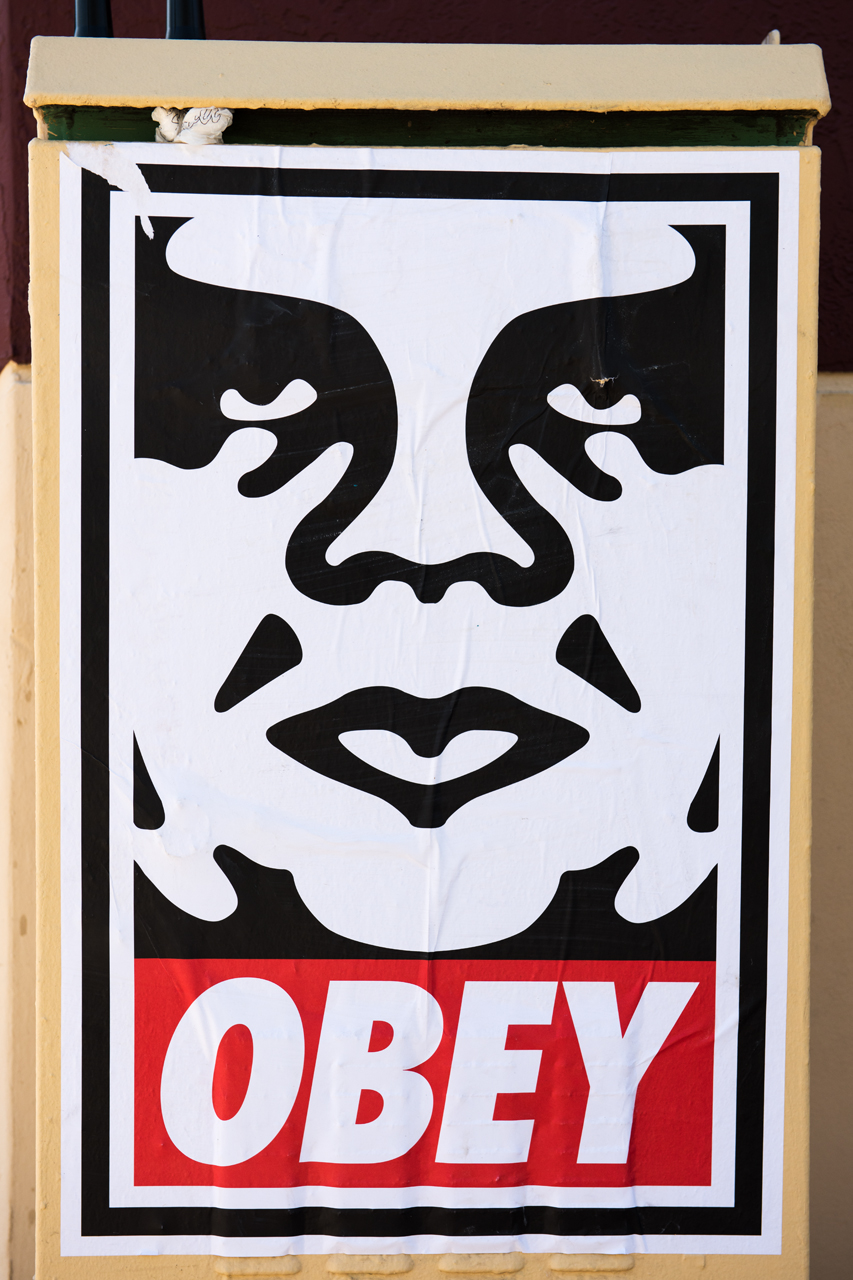 Obey Giant wheatpaste indicates artist Shepard Fairey is in town