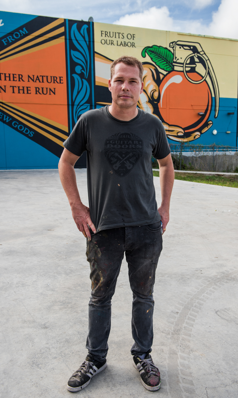 Shepard Fairey before his mural Fruits of Our Labor - Mother Nature on the run