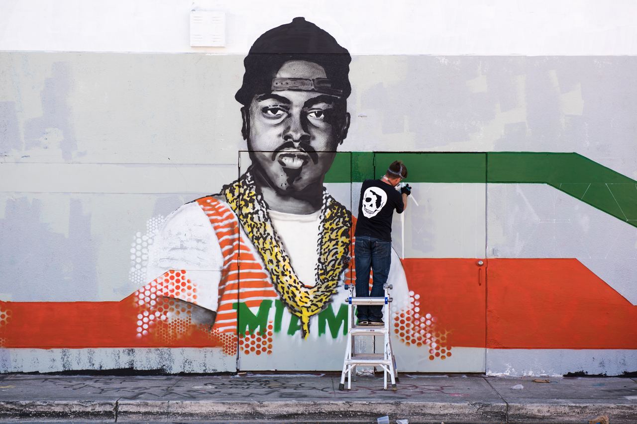 Bryan Deese at work on his mural of Mr Mixx, Miami music legend