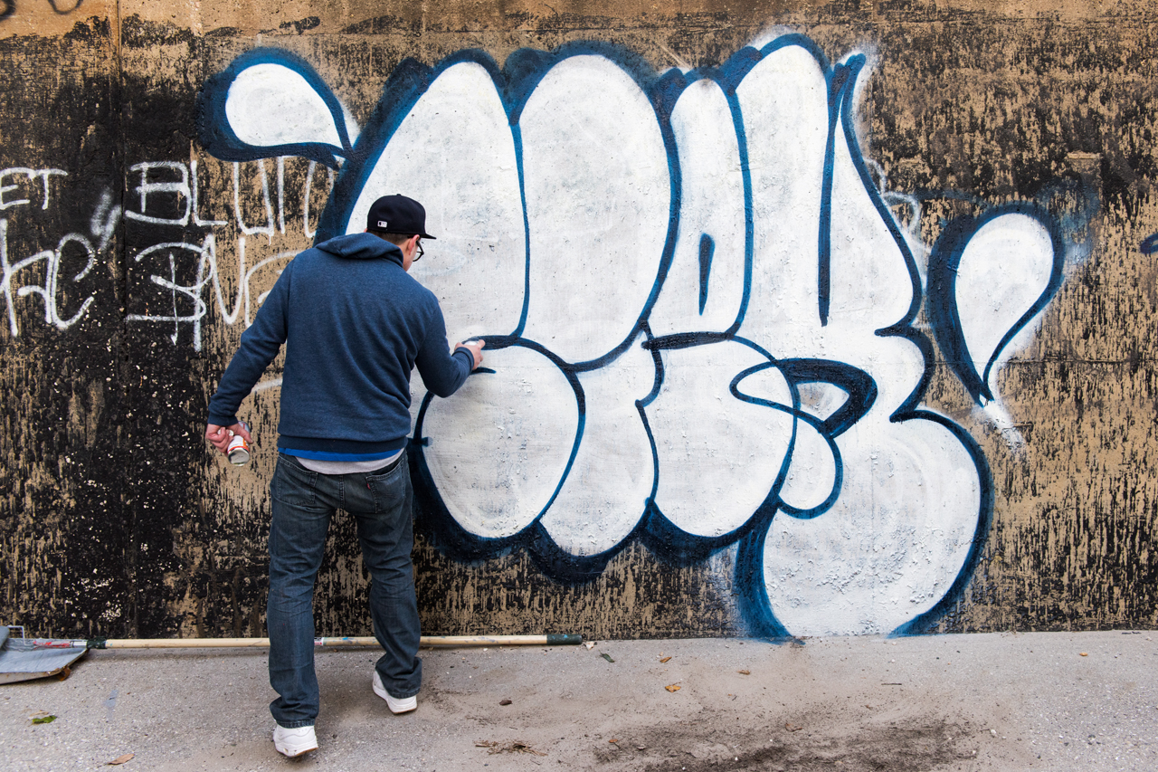 Siek at work on the Section 1 Art Park entrance wall