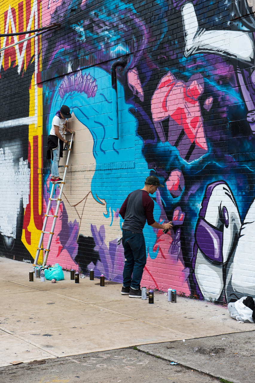 Lovenotes and Minuske at work on their collaborative mural