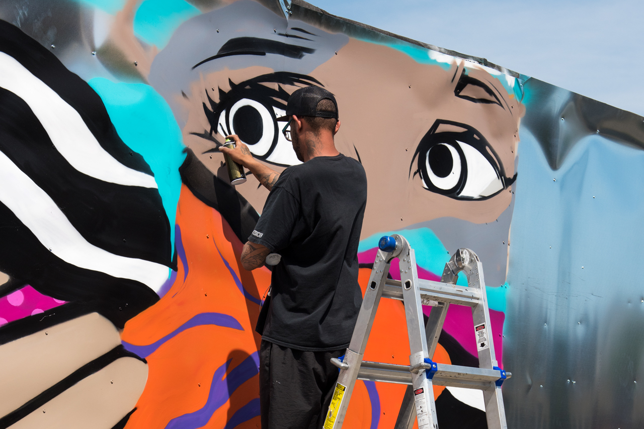 Mr Nerds at work on his mural