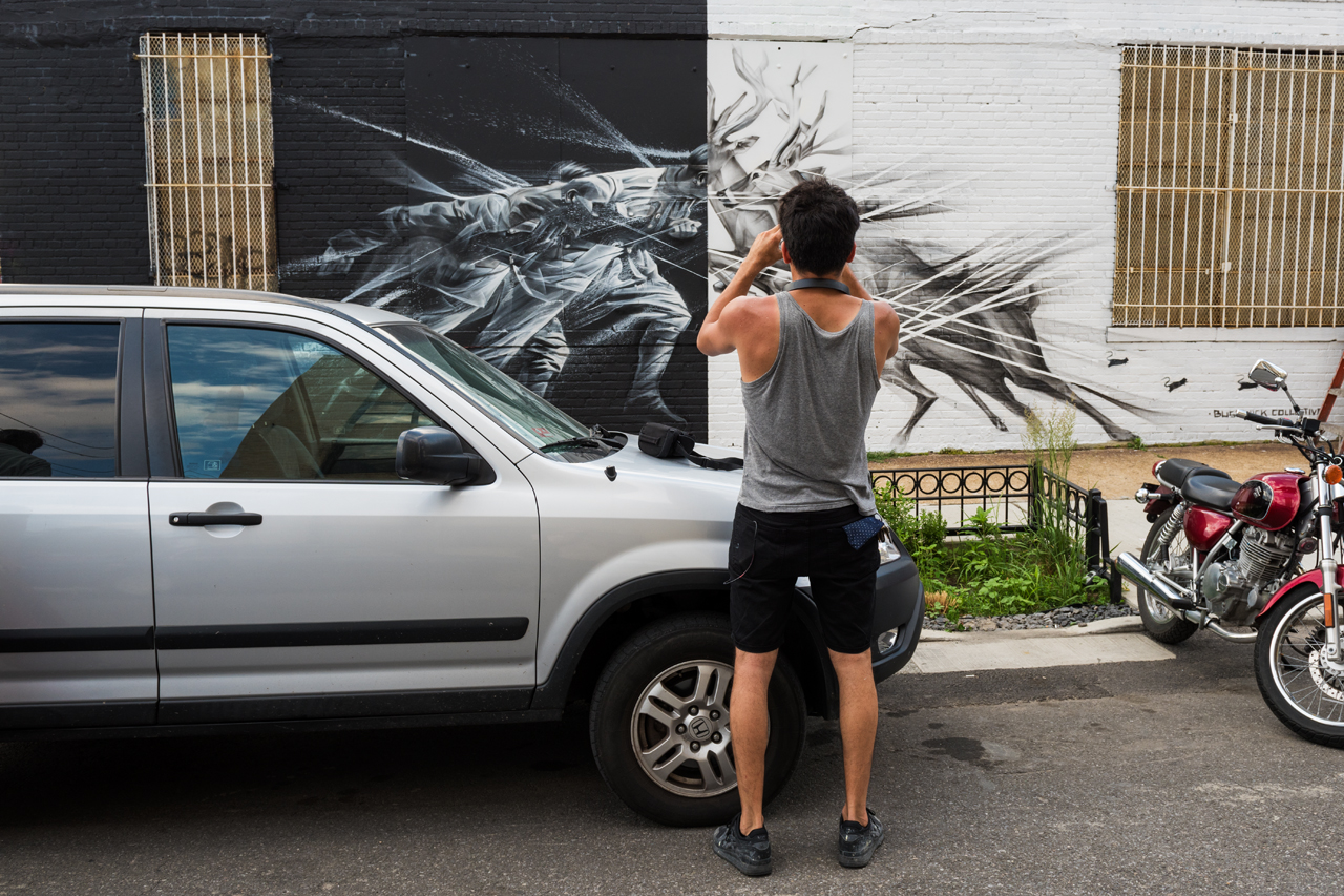 Li-Hill photographs his completed mural