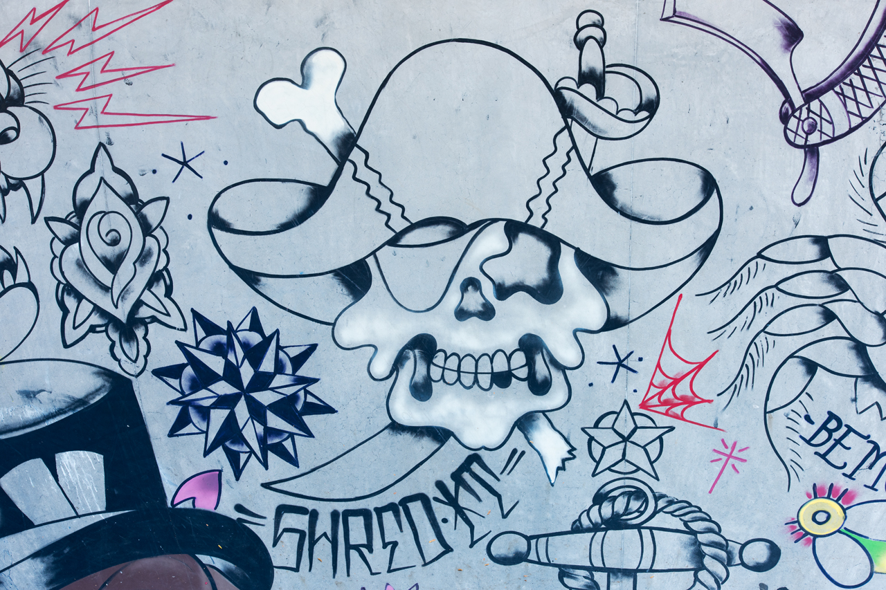 Headlining today's post ... Shred It, detail from the tattoo-themed mural by Adam Stab