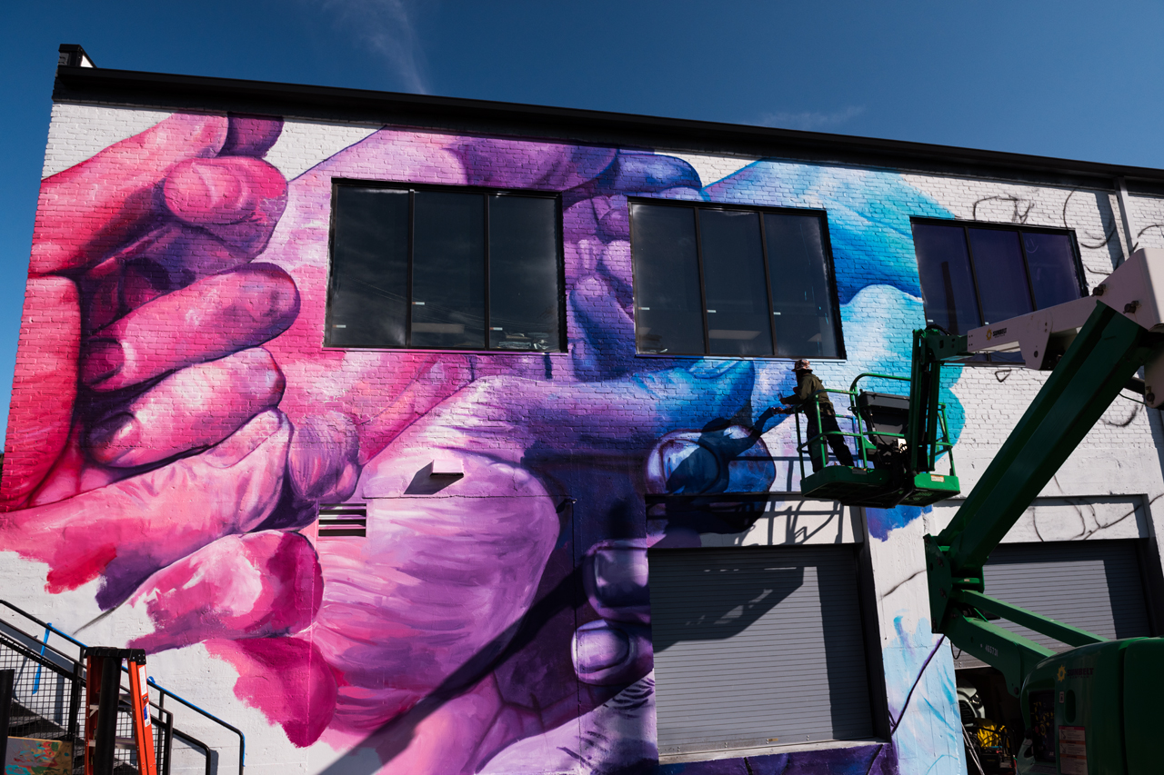 Afternoon view of the Open Works mural in progress